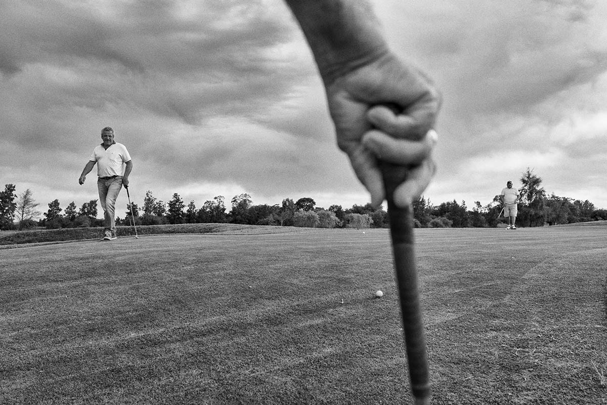 CHARATA, CHACO, ARGENTINA - APRIL 2014: A group of soybean farmers play golf in the golf club Charata. Charata is one of the main regions of production of soybeans and corn.