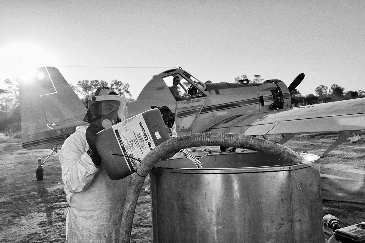 AVIA TERAI, CHACO, ARGENTINA - MAY 2014: A technician prepares the chemicals for fumigation in the tanks of an aircraft. Official studies show that in areas fumigated there is a rise in cases of cancer and malformations in newborns.