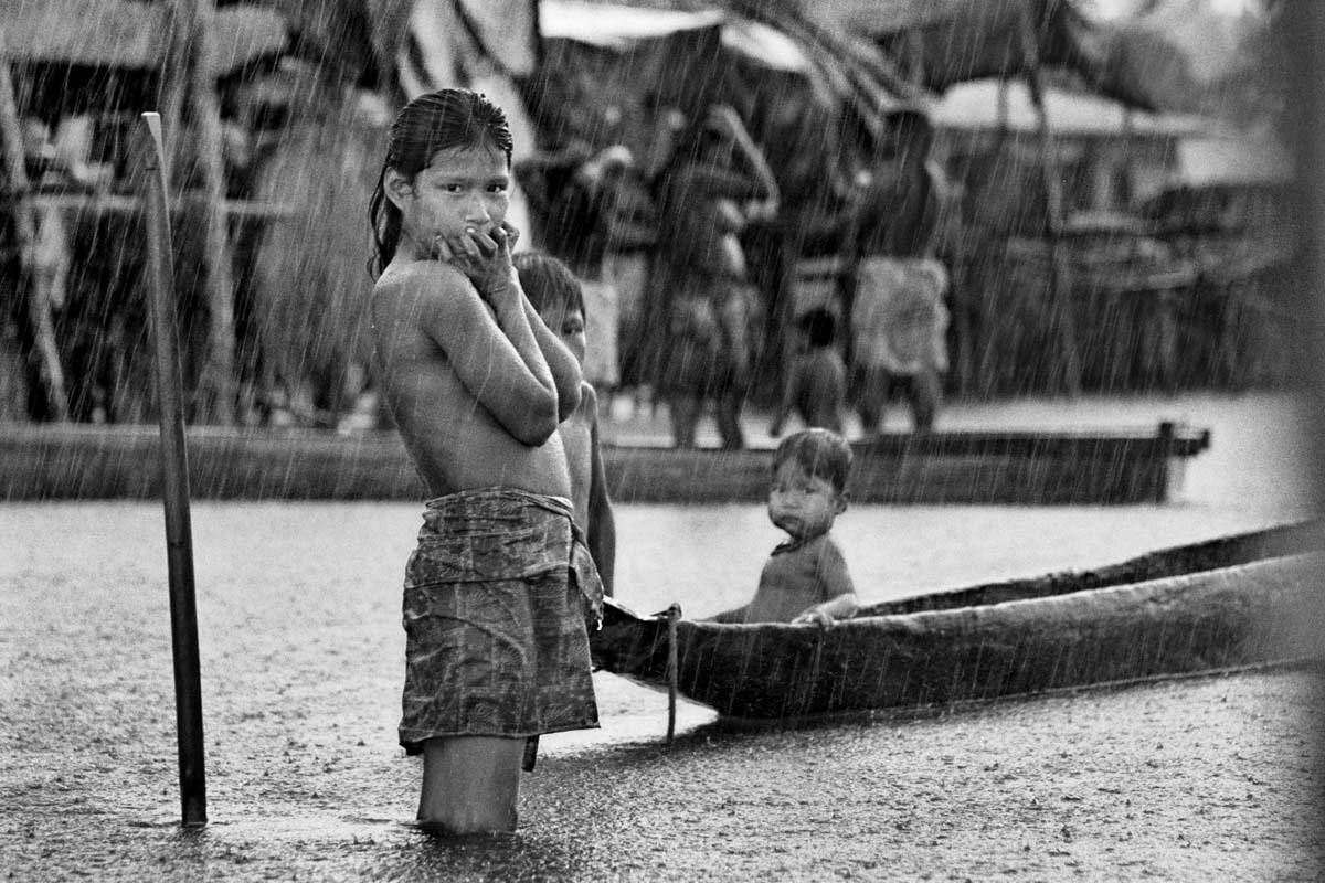 BOCA DE OPOGADO, CHOCÓ, COLOMBIA (2004) An internally displaced person (IDP). This child is an Embera Indian, a member of an indigenous population in Colombia. In 2004, there was fierce fighting between the right-wing paramilitary group Bloque Elmer Cardenas and left-wing FARC-EP in the region of the Rio Sucio. Today, the Council on Hemispheric Affairs puts the number of displaced persons in Colombia above half a million.
