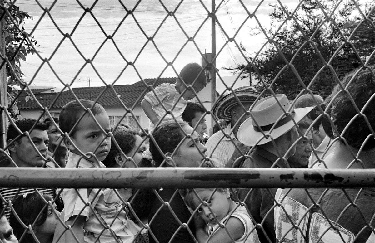 ALGECIRAS, COLOMBIA (2011) IDPs wait in line to receive supplies being distributed by the army.Colombia has been wracked by internal conflict for over half a century. The warring factions have included the government via its army; right-wing paramilitary groups, like the United Self-Defense Forces of Colombia (AUC); and left-wing guerrilla groups, such as the FARC-EP, the National Liberation Army (ELN), the M-19 (a group formed from the 19 of April Movement), and the Popular Liberation Army (EPL). A significant portion of the country has existed under the strict control of the different armed non-state actors.