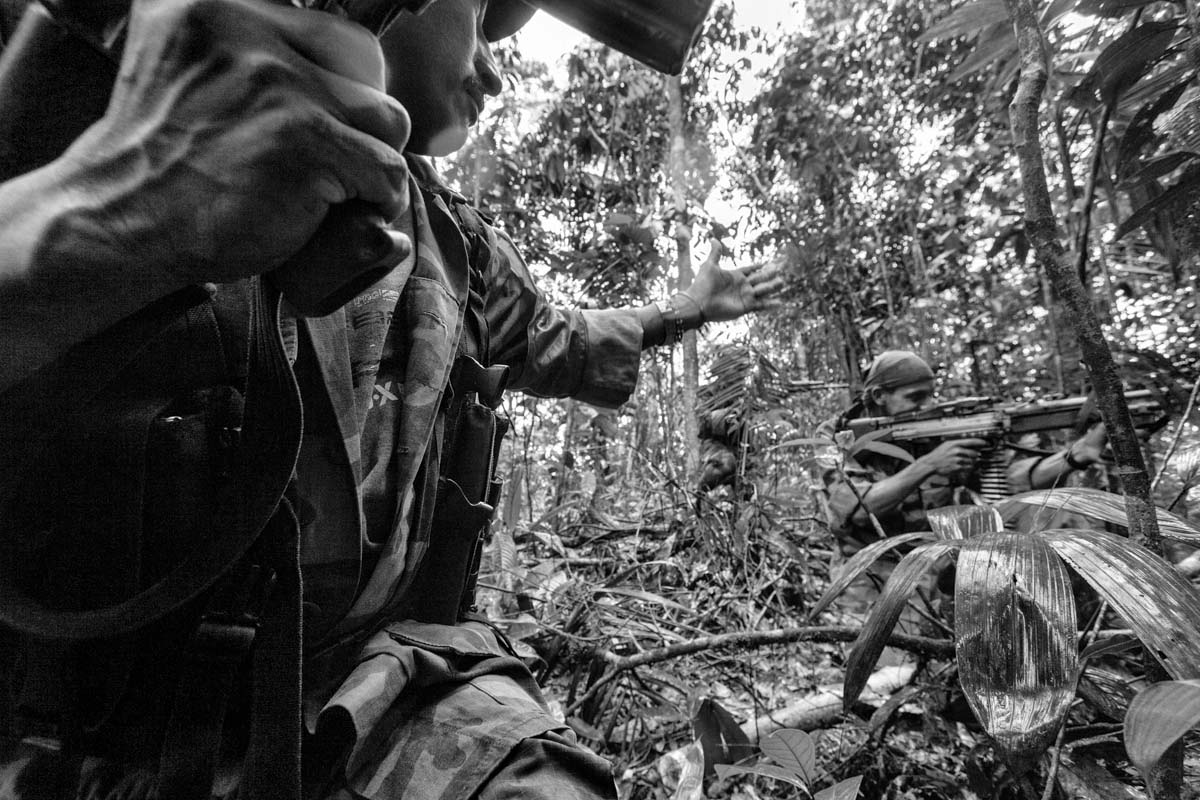 """SAN JUAN RIVER, CHOCÓ, COLOMBIA (2007) Members of the Bloque Móvil Arturo Ruíz during a patrol. This special unit of the FARC-EP fights in many different regions of Colombia and acts as a """"quick reaction force"""" to help other sub-groups of the FARC-EP."""