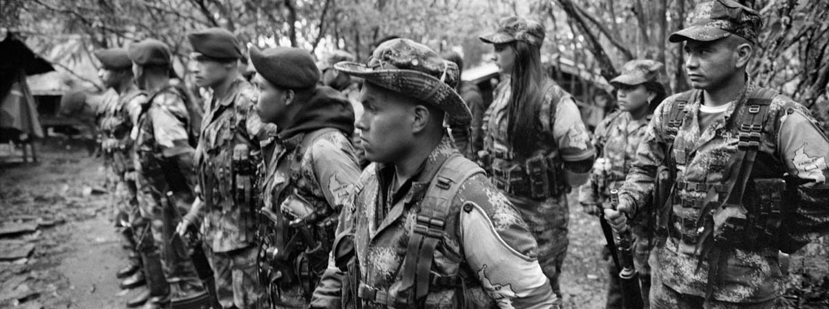 CAUCA, COLOMBIA - JULY 2016: Guerrilla members of the Western Bloc Alfonso Cano in training. For fty-two years, the FARC-EP has fought in the con ict in Colombia as an armed movement. With the peace agreements reached in Havana on August 24, 2016, FARC-EP begins its march towards a political movement.