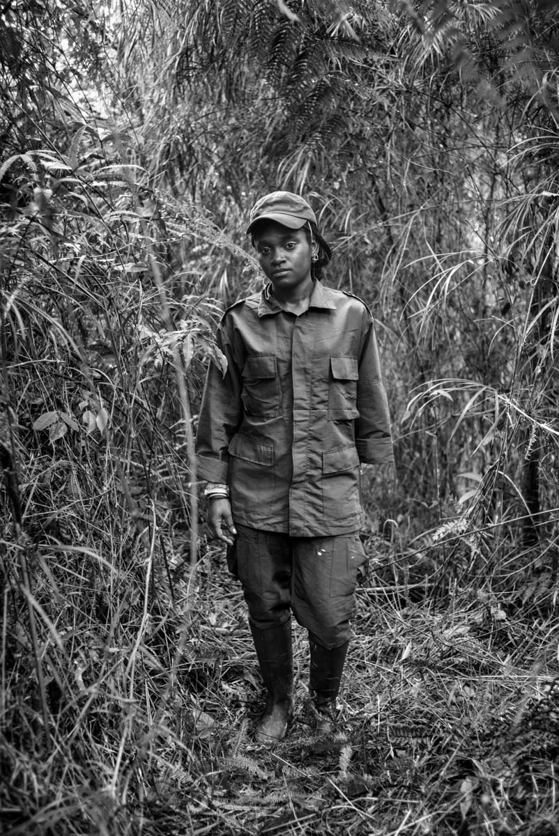 CAUCA, COLOMBIA - JULY 2016: Portrait of Maribel guerrilla members of the FARC-EP Western Bloc Alfonso Cano pose for a portrait. For fifty-two years, the FARC-EP has fought in the conflict in Colombia as an armed movement. With the peace agreements reached in Hava- na on August 24, 2016, it begins its march towards a political movement.