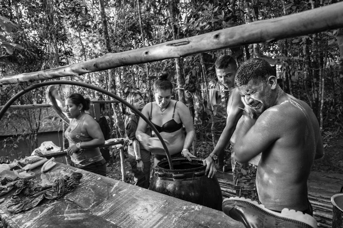 MUNICIPIO DE BUENOS AIRES, CAUCA, COLOMBIA (2016) A group of FARC-EP Western Bloc guerrilla members showering in one of their camps. Colombia has been wracked by internal conflict for over half a century. The warring factions have included the government via its army; right-wing paramilitary groups, like the United Self-Defense Forces of Colombia (AUC); and left-wing guerrilla groups, such as the FARC-EP, the National Liberation Army (ELN), the M-19 (a group formed from the 19 of April Movement), and the Popular Liberation Army (EPL). A significant portion of the country has existed under the strict control of the different armed non-state actors. With the peace agreements reached in Havana on August 24, 2016, FARC-EP it will begin to move towards becoming a political movement,