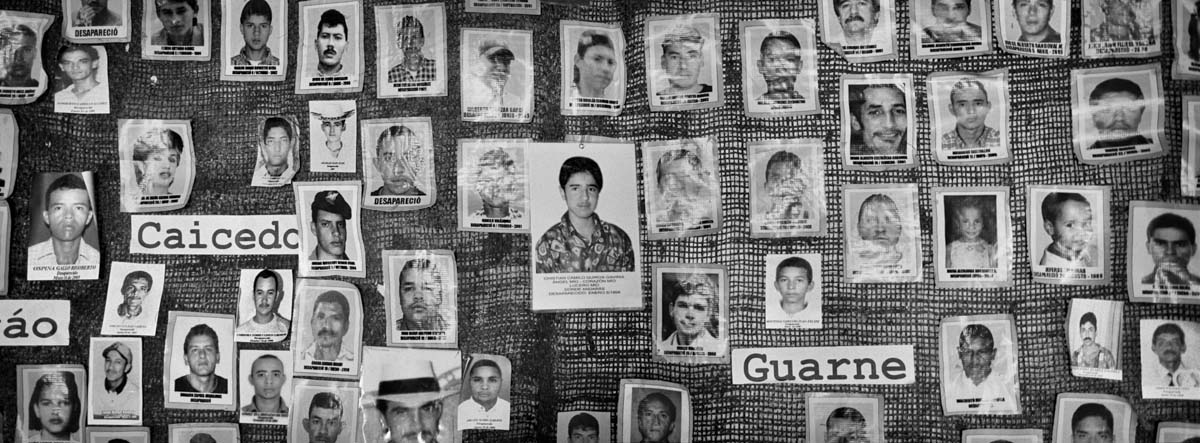 COLOMBIA, ANTIOQUIA - FEBRUARY 2015: A mural with photographs of missing persons because of the war in colombia. The Association of the mothers of the candelaria helps families with missing relatives. It was the first Association in Colombia which demanded answers about the fate of the missing 76,000 that exist in Colombia.
