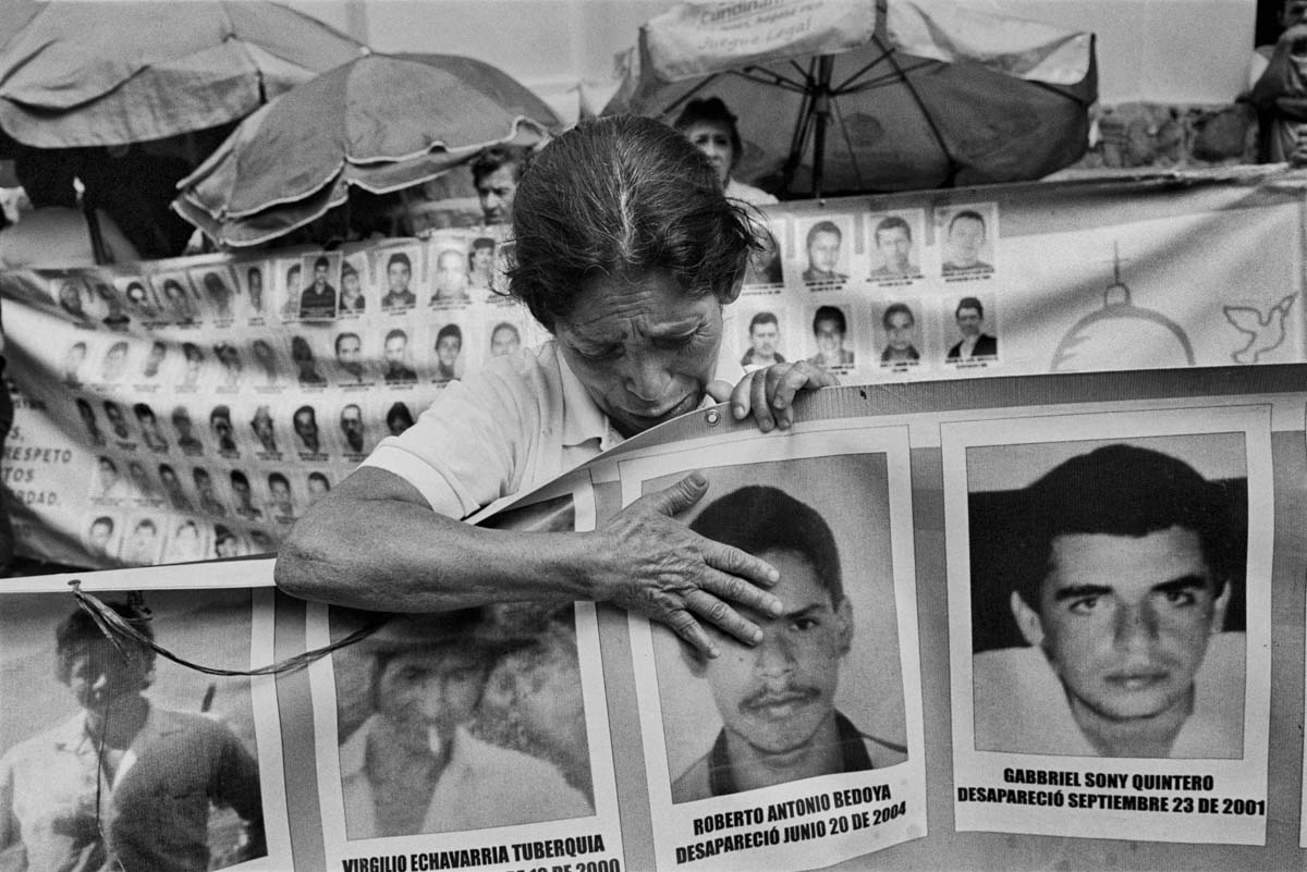 MEDELLÍN, ANTIOQUIA, COLOMBIA - FEBRUARY 2015. A mother cries for her missing son during a vigil in Medellín. Every Friday, the Association of Mothers of the Candelaria organizes a vigil to remember the missing and demand their return. There is no officially agreed-upon statistic for the number who have gone missing, but some estimates suggest that more than 96,000 people have disappeared.