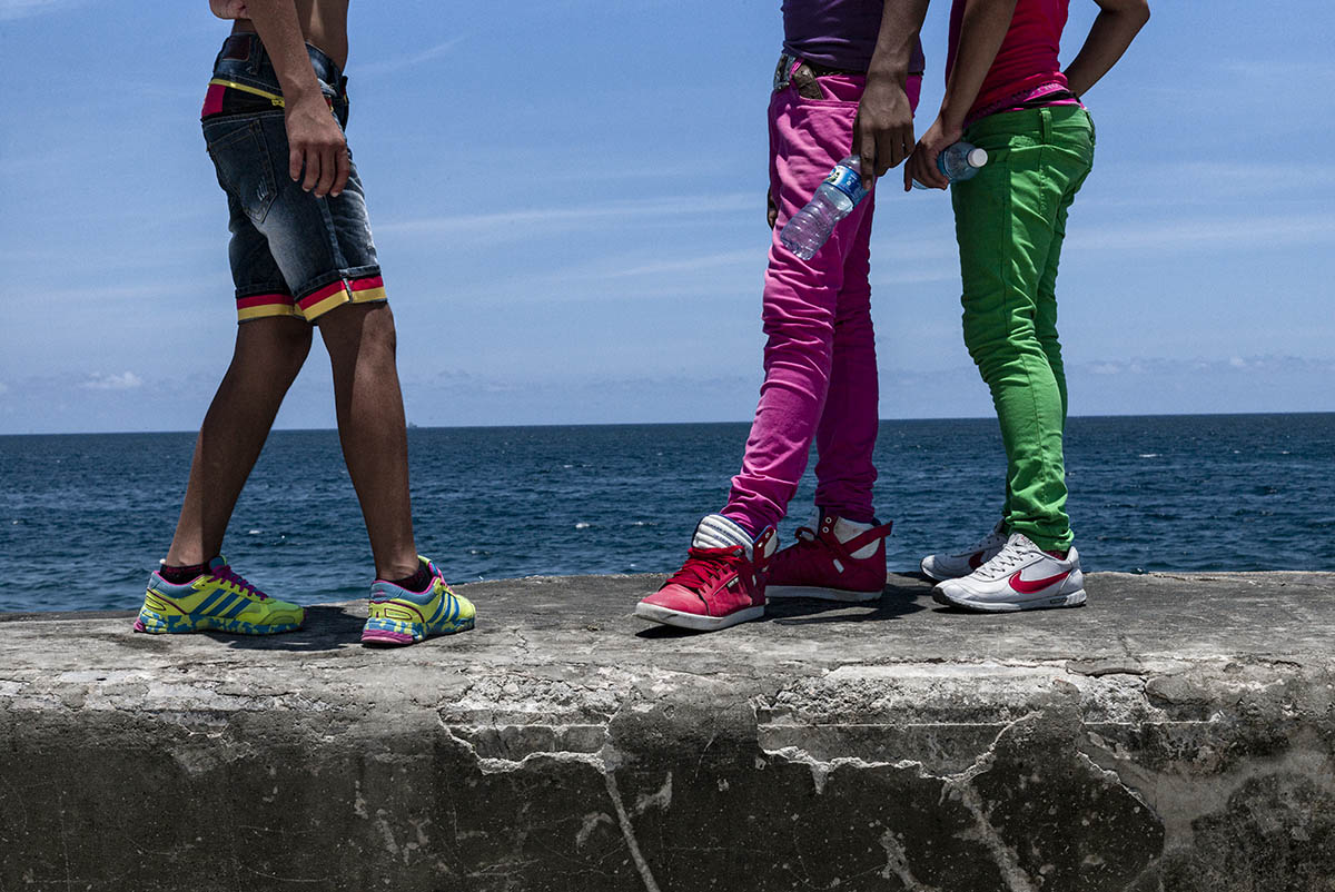 CUBA - MAY 2013: A group of young gay stroll along the Malecon of Havana. Pending legislation, the lesbian, gay, transgender and intersex fight for their rights.
