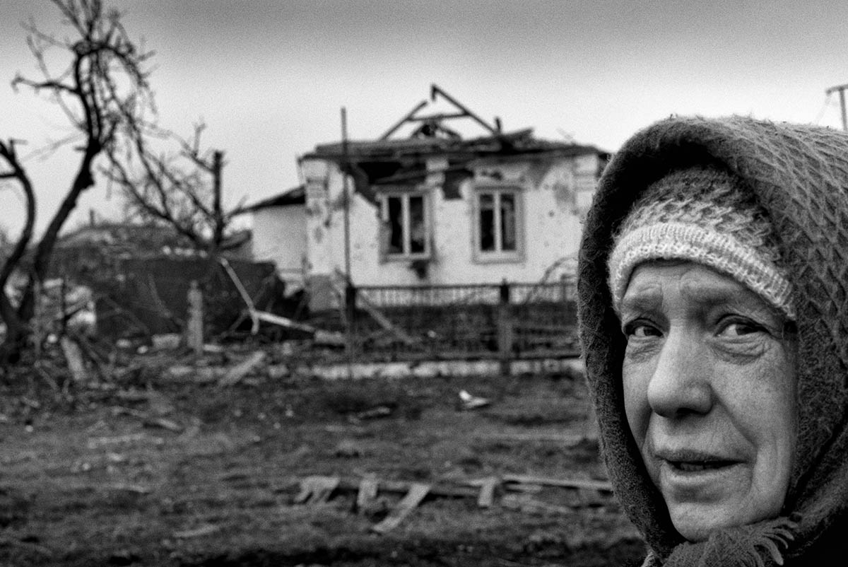 DONESTK, UKRAINE - FEBRUARY 2015: One of the few civilians who reamined in Nikishino during the fighting. inside their refuge in Nikishino. The few civilians who remained in Nikishino during the fighting lived in shelters underground. Nikisino has been one of the major front lines in the war in the East of Ukraine. After the fall of the strategic town of Debaltseve in separatist hands, Ukrainian troops also left this strategic line of the front leaving the community fully mined and converted into ashes. The remains of the Nikishino community attest to the drastic consequences of the war on the civilian population in the East of Ukraine.