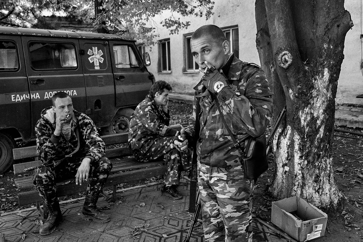 SHAKHTARSK, UKRAINE - OCTOBER 2014: A group of soldiers from the DPR smoke during a change of guard in the village of Shakhtarsk. Pro-Russian separatists in the Donetsk and Luhansk regions declared independence from Kiev and proclaimed their own people's republics after Russia annexed the Crimean peninsula from Ukraine in March. More than 2,000 civilians and combatants have been killed since mid-April, when Ukraine's government sent troops to put down the rebel uprising. Ukraine accuses Russia of arming the rebels and sending Russian soldiers into eastern Ukraine - a claim denied by the Kremlin.
