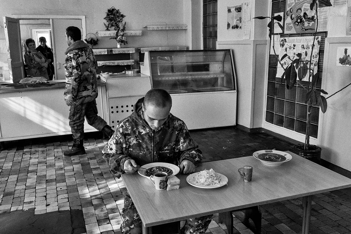 DONESTK, UKRAINE - OCTOBER 2014: A group of soldiers from the DPR lunch in the canteen of the military base in the district of Petrovsky. Pro-Russian separatists in the Donetsk and Luhansk regions declared independence from Kiev and proclaimed their own people's republics after Russia annexed the Crimean peninsula from Ukraine in March. More than 2,000 civilians and combatants have been killed since mid-April, when Ukraine's government sent troops to put down the rebel uprising. Ukraine accuses Russia of arming the rebels and sending Russian soldiers into eastern Ukraine - a claim denied by the Kremlin.