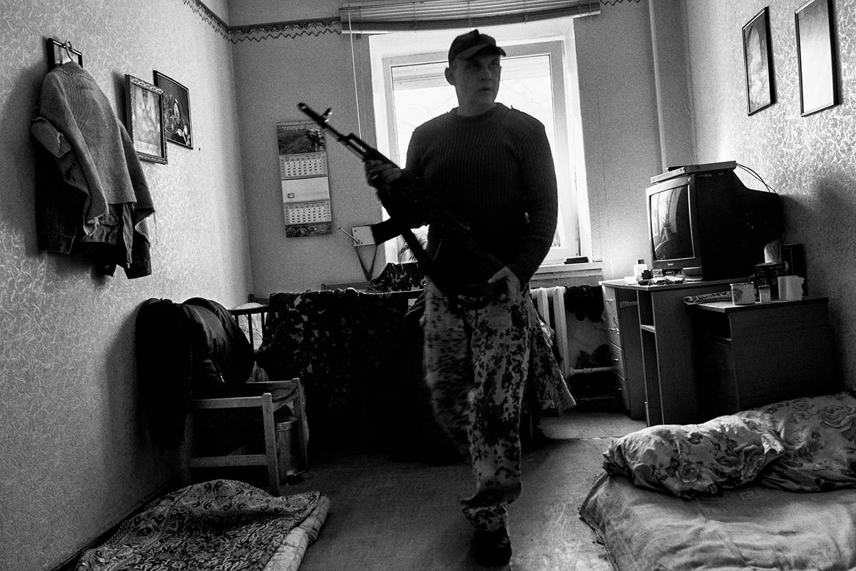 SHAKHTARSK, UKRAINE - OCTOBER 2014: A soldier from the DPR gets ready in his room inside the village of Shakhtarsk. Pro-Russian separatists in the Donetsk and Luhansk regions declared independence from Kiev and proclaimed their own people's republics after Russia annexed the Crimean peninsula from Ukraine in March. More than 2,000 civilians and combatants have been killed since mid-April, when Ukraine's government sent troops to put down the rebel uprising. Ukraine accuses Russia of arming the rebels and sending Russian soldiers into eastern Ukraine - a claim denied by the Kremlin.