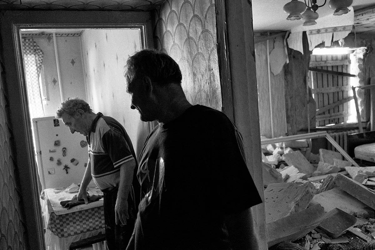 SLAVYANSK, UKRAINE - JULY 11: Two local men Vladimir (L) and Jacob (R) stand inside their destroyed house on July 11, 2014 in the village of Nicolaivka, near the eastern Ukrainian city of Slavyansk. Pro-Russian separatists in the Donetsk and Luhansk regions declared independence from Kiev and proclaimed their own people's republics after Russia annexed the Crimean peninsula from Ukraine in March. More than 2,000 civilians and combatants have been killed since mid-April, when Ukraine's government sent troops to put down the rebel uprising. Ukraine accuses Russia of arming the rebels and sending Russian soldiers into eastern Ukraine - a claim denied by the Kremlin.