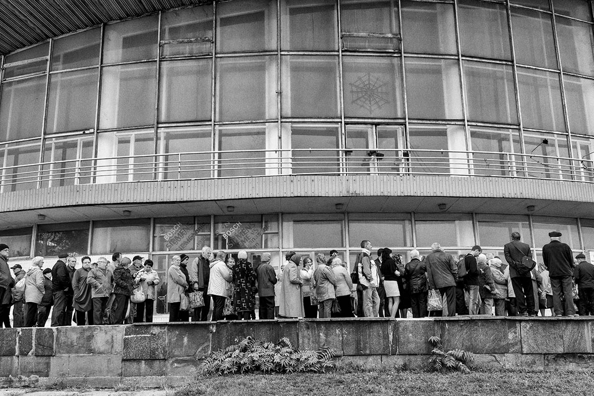 DONESTK, UKRAINE - OCTOBER 2014: A group of civilians wait their turn in a line to get food from a DPR humaniatian program. The DPR government helps with various humanitarian programs to support civilians. Pro-Russian separatists in the Donetsk and Luhansk regions declared independence from Kiev and proclaimed their own people's republics after Russia annexed the Crimean peninsula from Ukraine in March. More than 2,000 civilians and combatants have been killed since mid-April, when Ukraine's government sent troops to put down the rebel uprising. Ukraine accuses Russia of arming the rebels and sending Russian soldiers into eastern Ukraine - a claim denied by the Kremlin.