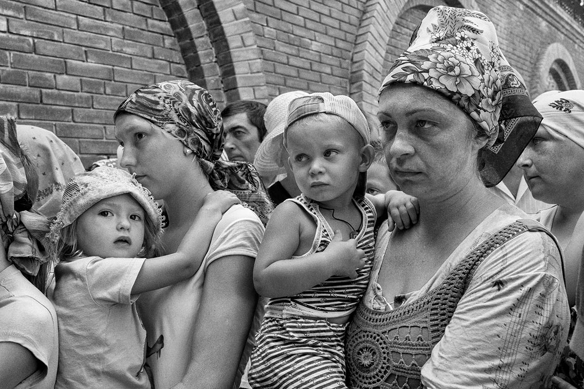 SLAVYANSK, UKRAINE - AUGUST 12: A group of refugees waiting their turn to get food August 12, 2014. Pro-Russian separatists in the Donetsk and Luhansk regions declared independence from Kiev and proclaimed their own people's republics after Russia annexed the Crimean peninsula from Ukraine in March. More than 2,000 civilians and combatants have been killed since mid-April, when Ukraine's government sent troops to put down the rebel uprising. Ukraine accuses Russia of arming the rebels and sending Russian soldiers into eastern Ukraine - a claim denied by the Kremlin.