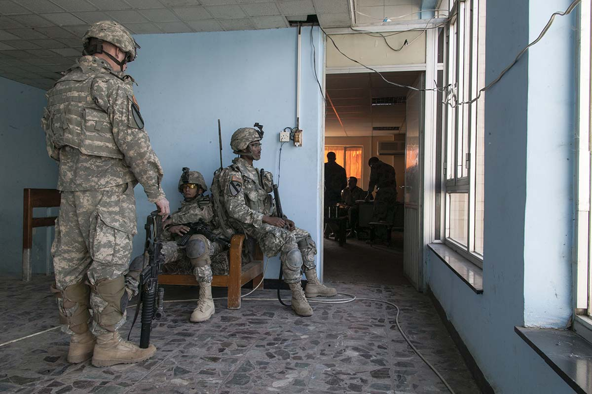 BAGHDAD, IRAQ - NOVEMBER 2007: US Army QRF inside their base before going out on patrol in Baghdad.
