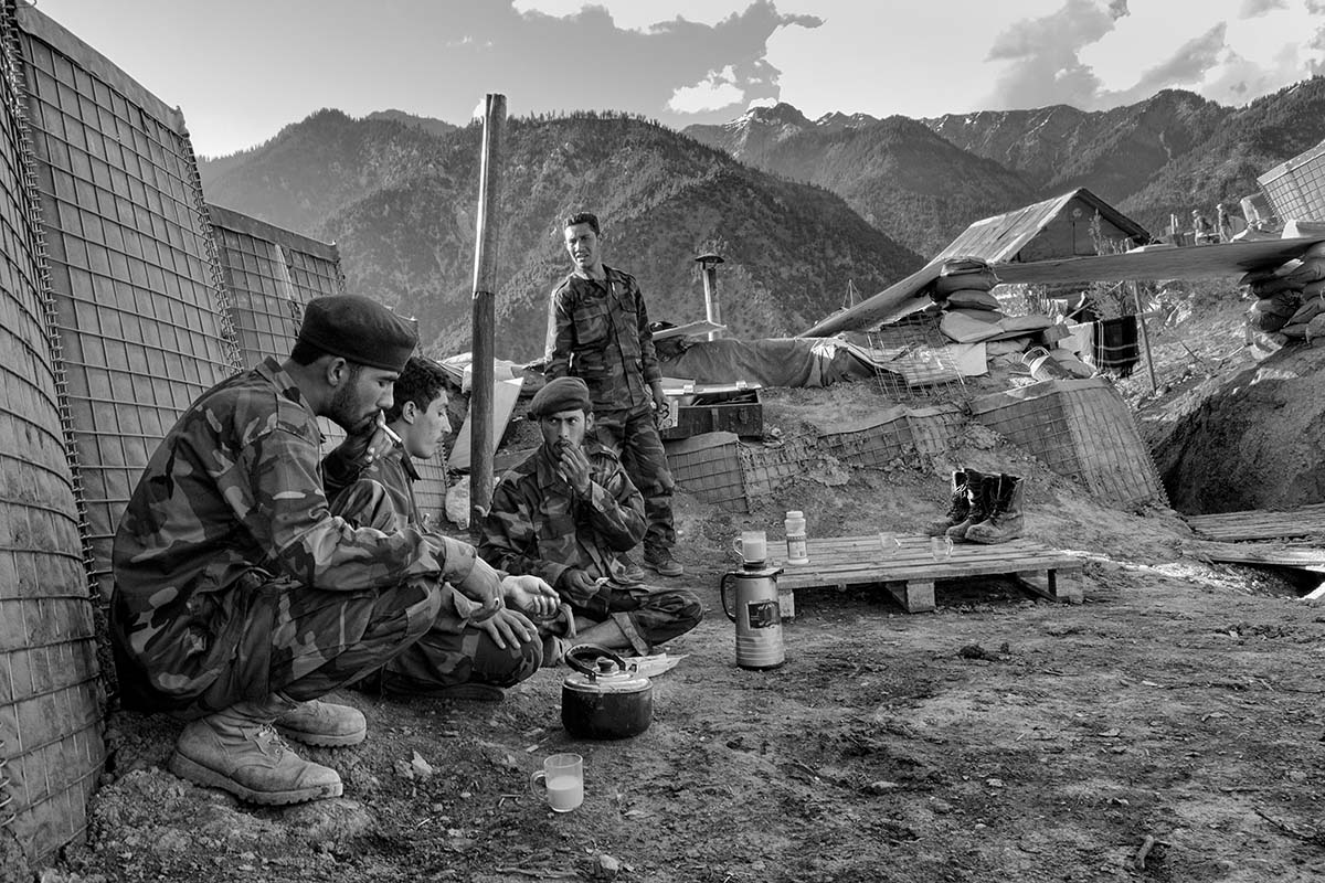 URSTAN PASS, AFGHANISTAN - MAY 2007: Soldiers from the Afghan National Army, Weapons Company, 2¼ Kandak 3 Brigade 201 Corp., based in Gowardehs OP (observations post) 3 miles from the border with Pakistan (Nuristan Region) take a break. This company has soldiers from all the different tribes living in Afghanistan.