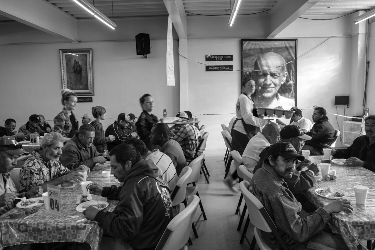 "TIJUANA, BAJA CALIFORNIA, MEXICO - MARCH, 2017: A group of illegal immigrants who try to reach the US or who have been deported have breakfast in the Salesian dining room ""Padre Chava"""