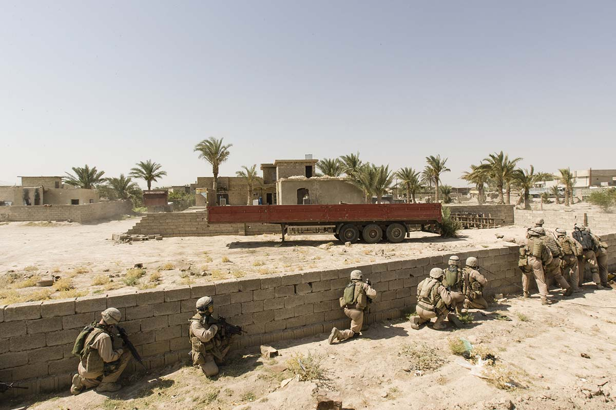 FALLUJAH, IRAQ - JULY 2006: US marines from Bravo Company out on patrol in Fallujah. Fallujah continues to be a symbol for the Iraqi resistance, and is the most insurgent-hit city of Iraq, full of destruction, dust, and dead. Since the major US troop operations in 2005, the daily lives of civilians and marines inside the city have become a fight to stay alive.