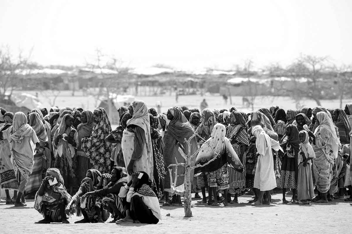 BAHAI, CHAD - APRIL 2005: The long wait to receive food is part of daily life in refugee camps in Chad. Without humanitarian aid it woud be nearly impossible for the refugees to survive.