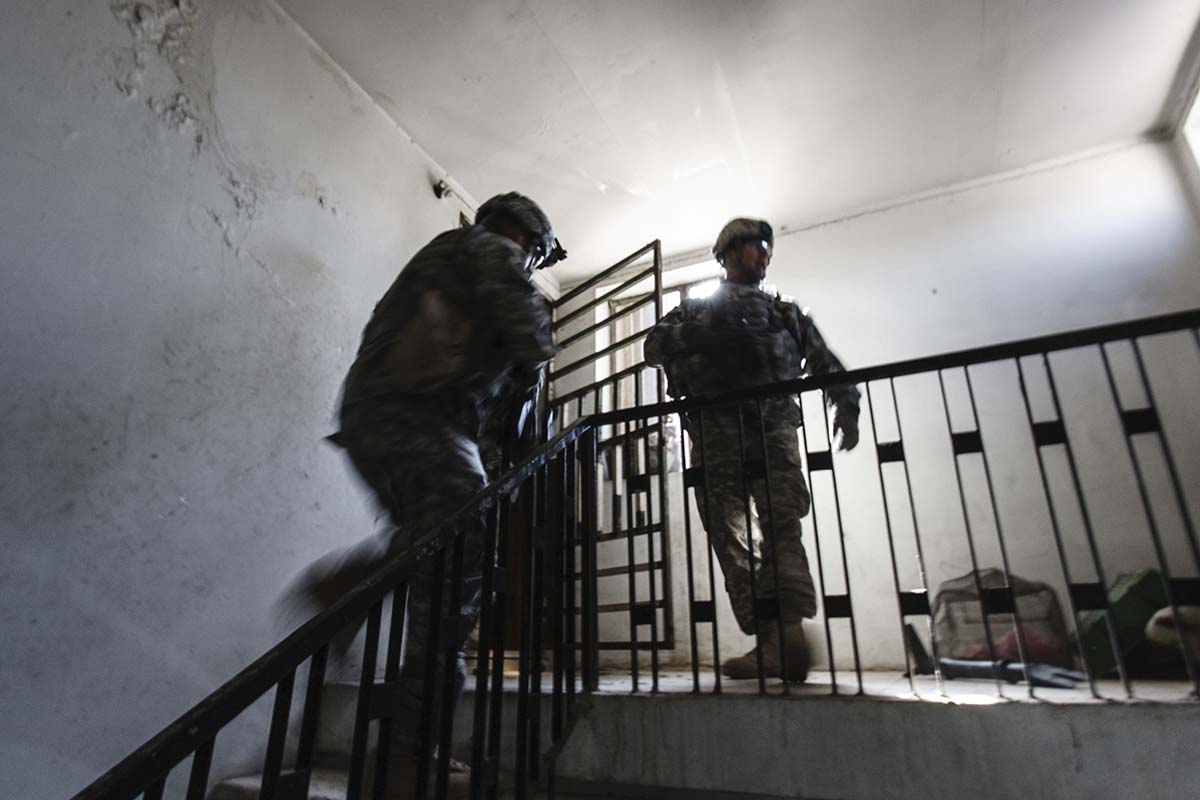 BAGHDAD, IRAQ - NOVEMBER 2007: An Iraqi police unit searching a house in their own Karrada neighborhood in Baghdad, with Bravo Company, 2nd Platoon of the 1st Calvary Division, from Fort Hood, Texas.