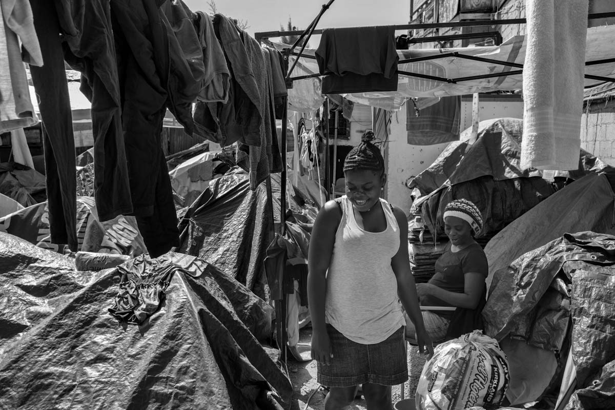 "TIJUANA, BAJA CALIFORNIA, MEXICO - MARCH, 2017: A group of Haitian refugee women rest in the improvised abergue of the ""Jueves 2021"". During the last year an avalanche of Haitian emigrants arrived in Tijuana trying to cross into the US. Most of the refugees were rejected by the US and currently live on charity in TIjuana in a total legal limbo."