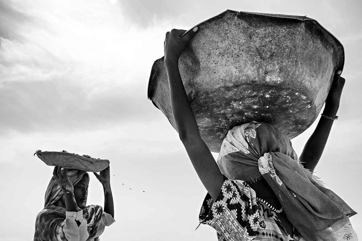 CHAD - SEPTEMBER 2008: Two women refugees working outside the Iribime camp. The woman suffer continuous attacks when the go out in search of wood, or to work, outside the camps.