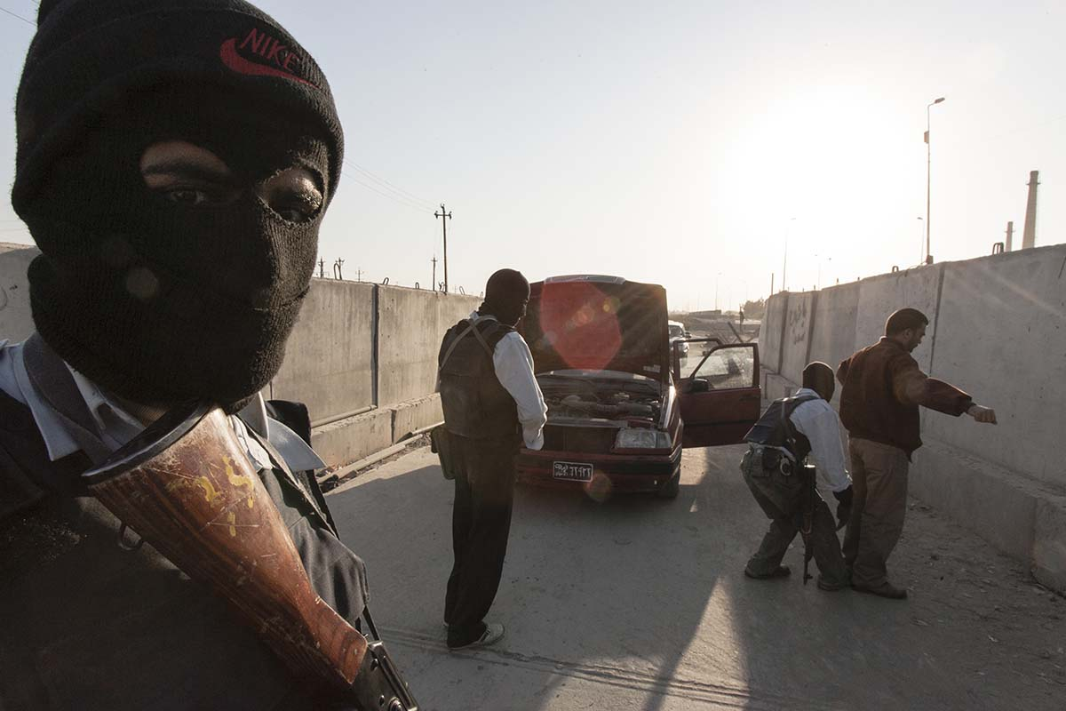 RAMADI, IRAQ - NOVEMBER 2007: A checkpoint on the road into Ramadi from Baghdad. These Iraqi policemen are former members of a local Sunni militia in Ramadi.