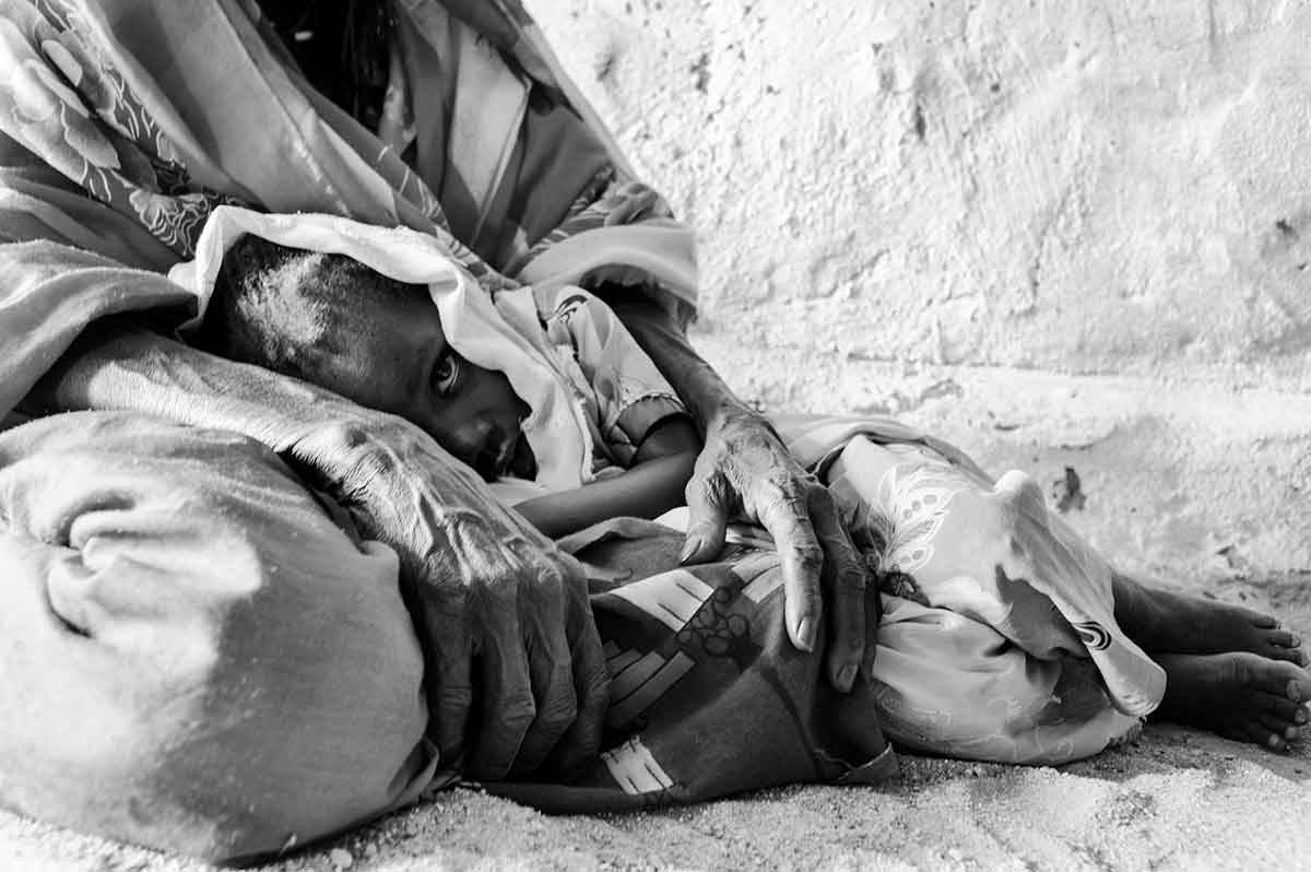 CHAD - SEPTEMBER 2008: A sick child being cradeled byt one of their parents, in Iriba, Chad.