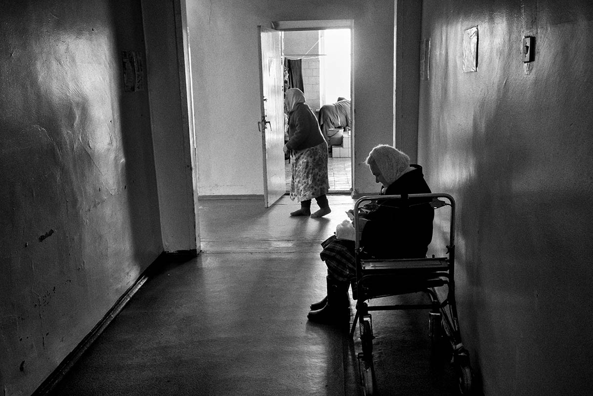 DONESTK, UKRAINE - FEBRUARY 2015: Two women inside a public hospital in Donetsk. Hospitals in Donetsk survive on the basics. Because of the war all hospitals in the territory controlled by the rebels are without supplies. The city of Donetsk is daily target of Ukrainian artillery. Since the beginning of the war, the airport peripheral neighborhoods have been victims of the bombing. Today the area is totally destroyed.