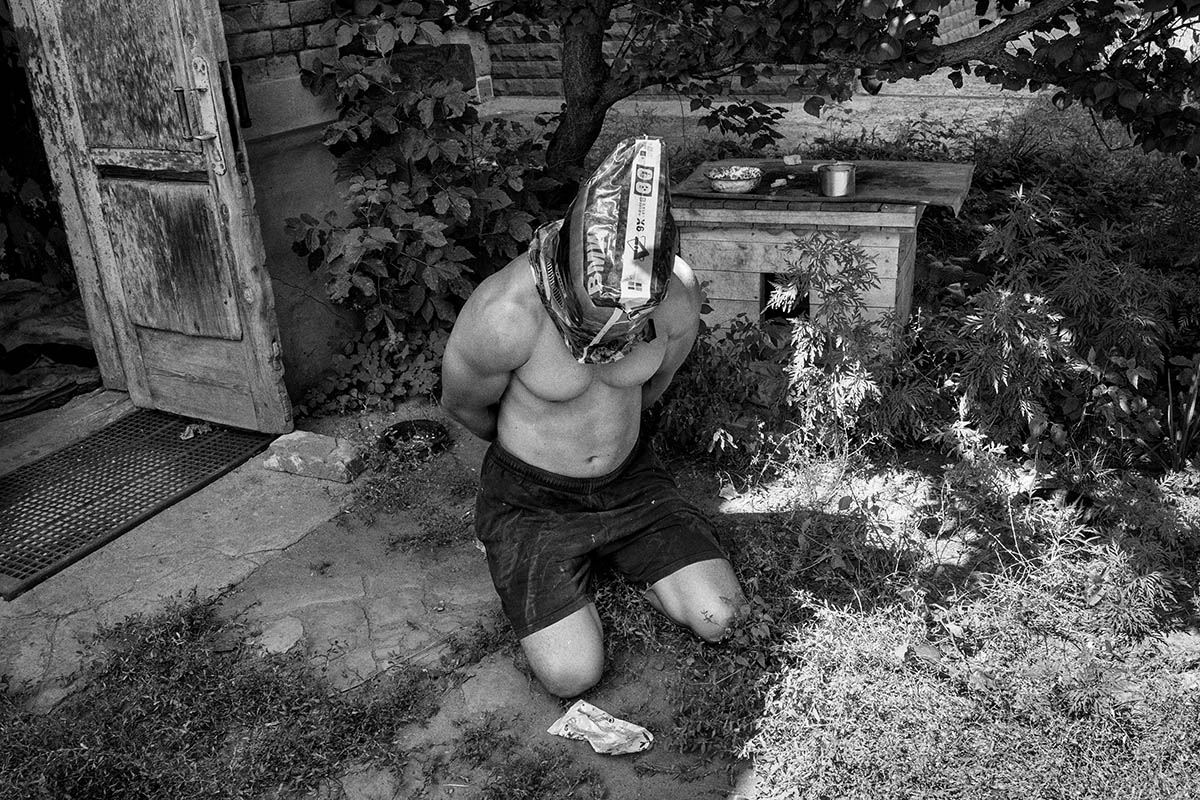 SLAVYANSK, UKRAINE - AUGUST 08: A Pro-russian figther prisioner waits in the ground to be taken for interrogation by Figthers from the Kiev One batallion, a pro-Ukrainian paramilitary volunteer battallion on August 08, 2014 in the village of Slavyansk. Pro-Russian separatists in the Donetsk and Luhansk regions declared independence from Kiev and proclaimed their own people's republics after Russia annexed the Crimean peninsula from Ukraine in March. More than 2,000 civilians and combatants have been killed since mid-April, when Ukraine's government sent troops to put down the rebel uprising. Ukraine accuses Russia of arming the rebels and sending Russian soldiers into eastern Ukraine - a claim denied by the Kremlin.