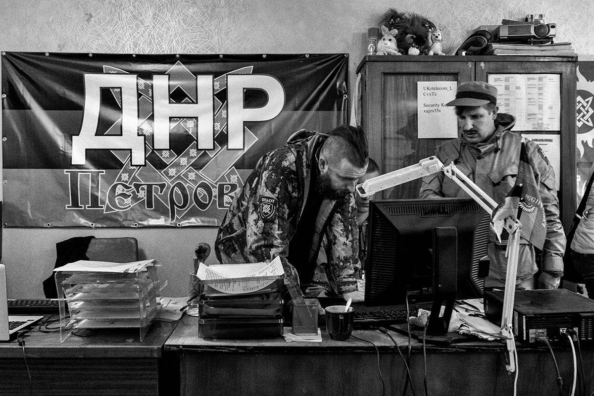 DONESTK, UKRAINE - OCTOBER 2014: A group of soldiers from the DPR within the command post in the district of Petrovsky. Pro-Russian separatists in the Donetsk and Luhansk regions declared independence from Kiev and proclaimed their own people's republics after Russia annexed the Crimean peninsula from Ukraine in March. More than 2,000 civilians and combatants have been killed since mid-April, when Ukraine's government sent troops to put down the rebel uprising. Ukraine accuses Russia of arming the rebels and sending Russian soldiers into eastern Ukraine - a claim denied by the Kremlin.
