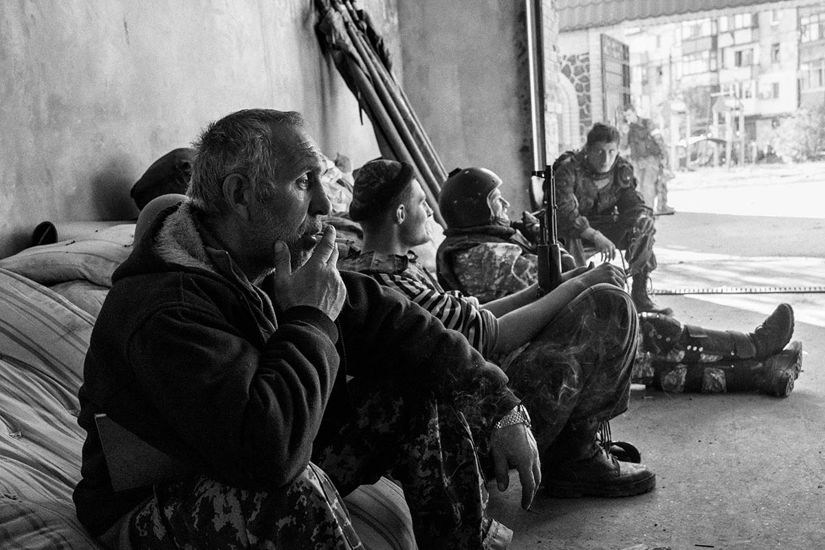 DONESTK, UKRAINE - OCTOBER 2014: A group of figthers from the Motorola Batallon that fight inside the Donestk airport during a rest. Pro-Russian separatists in the Donetsk and Luhansk regions declared independence from Kiev and proclaimed their own people's republics after Russia annexed the Crimean peninsula from Ukraine in March. More than 2,000 civilians and combatants have been killed since mid-April, when Ukraine's government sent troops to put down the rebel uprising. Ukraine accuses Russia of arming the rebels and sending Russian soldiers into eastern Ukraine - a claim denied by the Kremlin.