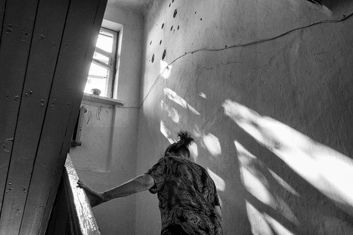 SLAVYANSK, UKRAINE - AUGUST 10: A woman walks inside her home damaged during the fighting on August 10, 2014 in the village of Semyonovka, near the eastern Ukrainian city of Slavyansk. Pro-Russian separatists in the Donetsk and Luhansk regions declared independence from Kiev and proclaimed their own people's republics after Russia annexed the Crimean peninsula from Ukraine in March. More than 2,000 civilians and combatants have been killed since mid-April, when Ukraine's government sent troops to put down the rebel uprising. Ukraine accuses Russia of arming the rebels and sending Russian soldiers into eastern Ukraine - a claim denied by the Kremlin.
