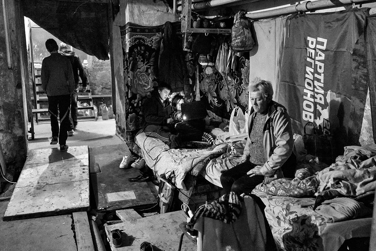 DONESTK, UKRAINE - OCTOBER 2014: A group of civilians inside a shelter from the Soviet era at the Petrovsky district. Civilians shelter from the Ukrainian artillery in places like this all over Donestk. Pro-Russian separatists in the Donetsk and Luhansk regions declared independence from Kiev and proclaimed their own people's republics after Russia annexed the Crimean peninsula from Ukraine in March. More than 2,000 civilians and combatants have been killed since mid-April, when Ukraine's government sent troops to put down the rebel uprising. Ukraine accuses Russia of arming the rebels and sending Russian soldiers into eastern Ukraine - a claim denied by the Kremlin.
