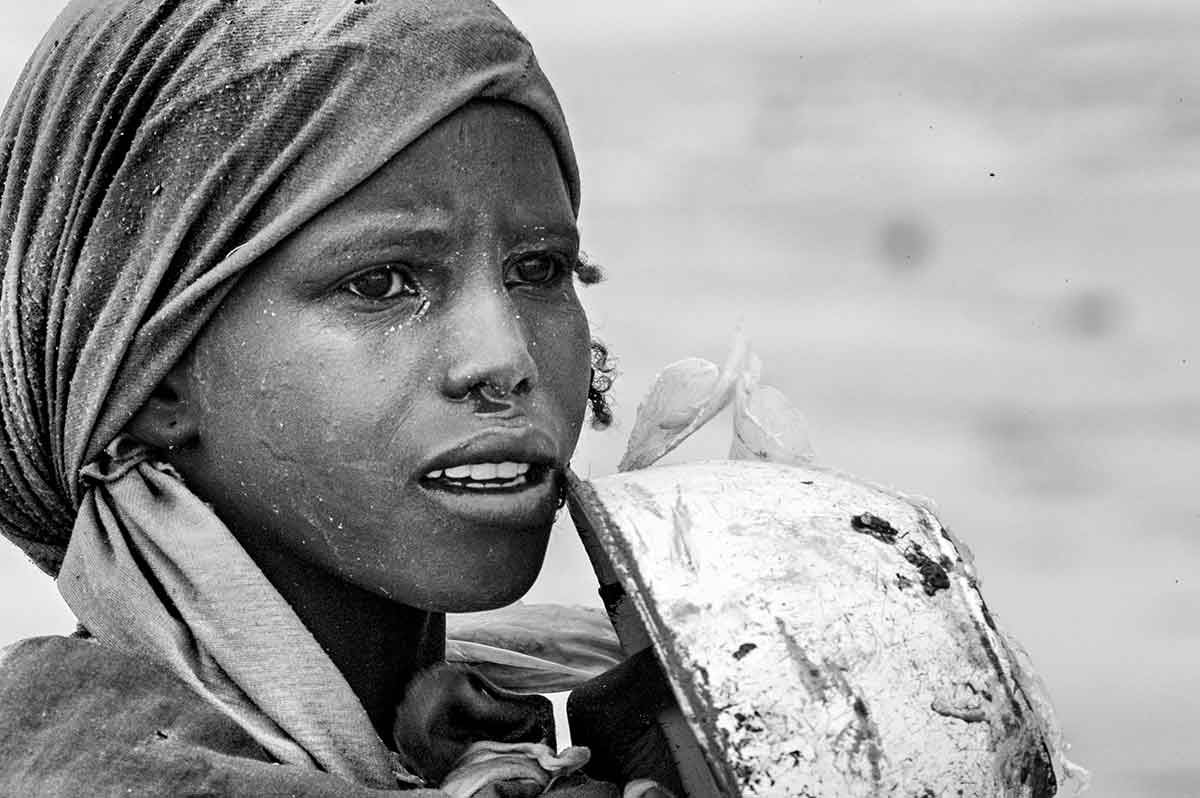 DARFUR, SUDAN - APRIL 2005: A girl fleeing from the genocide in Darfur.