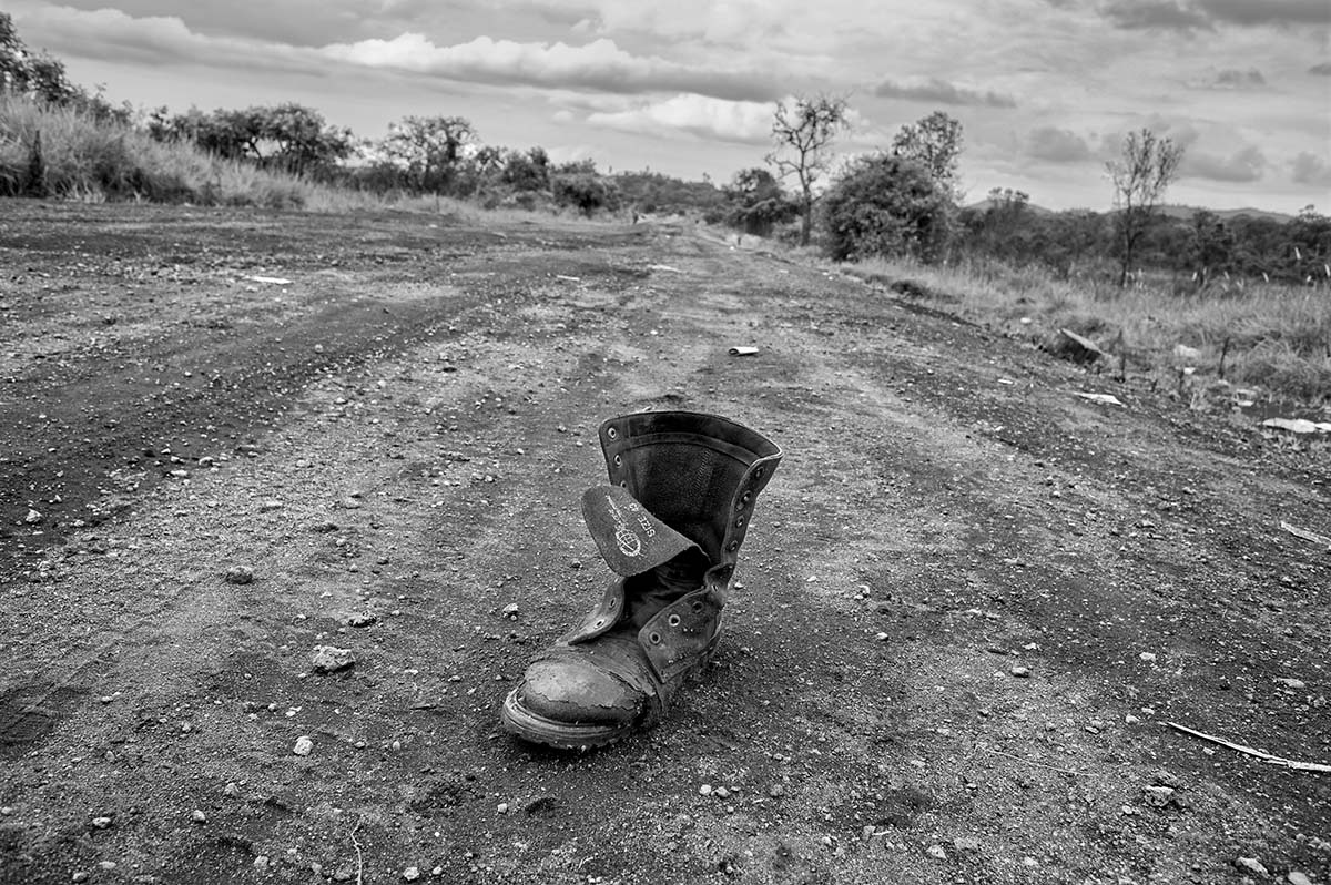 DEMOCRATIC REPUBLIC OF CONGO, NOVEMBER 2008: The boot of a dead FRDC (Congolese Army) soldier on the road between Kibati and Rusturu.