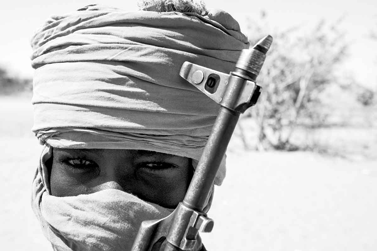 DARFUR, SUDAN - APRIL 2005: A child soldier member of the SLA (Sudanese Liberation Army) guerrillas, one of the rebel groups fighting against the Sudanese goverment in Khartoum.