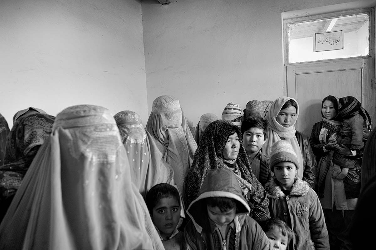 KABUL, AFGHANISTAN - FEBRUARY 2009: Waiting line in the Institute for Malaria and Leishmaniasis, which receives 50 new patients per day, and 200 returning patients. These illnesses are spread through mosquitos, who are able to reproduce readily in the crumbling houses of Kabul. Their bites can cause skin infections and internal ulcers which inflame the spleen and liver, and can end up being fatal. There are so many cases that the medicine used as an effective treatment if taken for a month and half, at the cost of around USD $150, is running out. Afghanistan has become the key war zone for the new US administration. After years of focus on Iraq, the US government has realized how critical an issue Afghanistan really is. It is a country all too used to broken promises, used to death and used to fighting for its survival. Afghans have increasingly lost hope, and have lost faith in the promises made by the Western World. They now seem focussed on daily survival despite the hardships and social issues that they face on a constant basis.