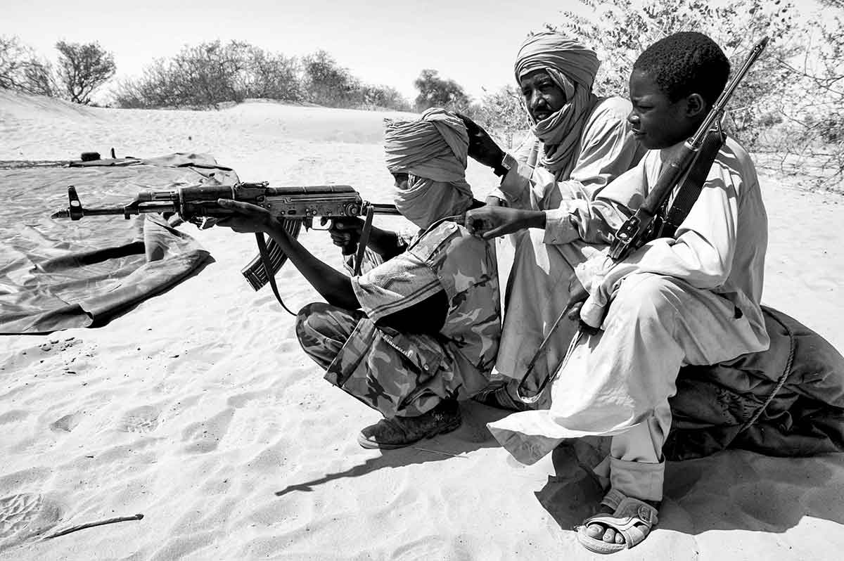 DARFUR, SUDAN - APRIL 2005: Child soldier members of the SLA (Sudanese Liberation Army) guerrillas, one of the rebel groups fighting against the Sudanese goverment in Khartoum.