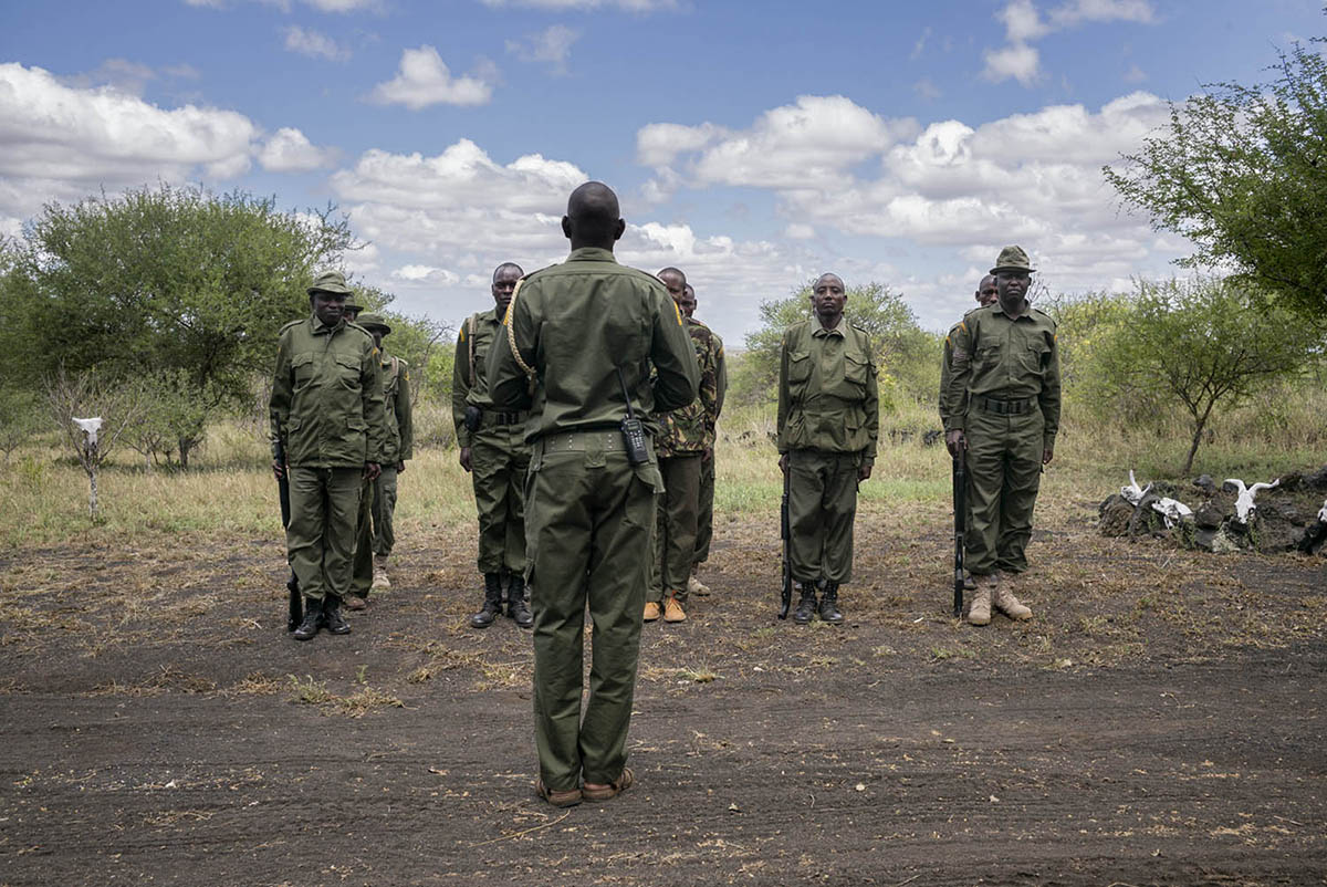 KENIA, AMBOSELI - FEBRUARY 2016: Rangers unit belonging to the foundation Big Life Foundation hope in training while captain informs them of the mission.